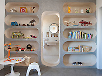 In the children's bedroom, shelving with round ends has been created from tadelakt plaster, incorporating an open doorway that leads to an en suite bathroom.