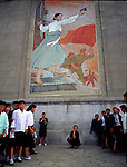 NR00011/Man posing in front of a revolutionary mosaic in Pyongyang..COREE DU NORD/NORTH KOREA.Avril 2000