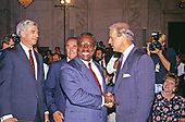 United States Senator Joseph Biden (Democrat of Delaware), Chairman, US Senate Judiciary Committee, second right, welcomes Judge Clarence Thomas, center, to the hearing before the US Senate Judiciary Committee to confirm him as Associate Justice of the US Supreme Court in the US Senate Caucus Room in Washington, DC on September 10, 1991.  Pictured from left to right: US Senator John Danforth (Republican of Missouri);  US Senator Strom Thurmond (Republican of South Carolina), Ranking Member; Judge Thomas; Chairman Biden; and Virginia Thomas, wife of the nominee, can be seen in the lower right corner of the photo.  Thomas was nominated for the position by US President George H.W. Bush on July 1, 1991 to replace retiring Justice Thurgood Marshall.<br /> Credit: Arnie Sachs / CNP