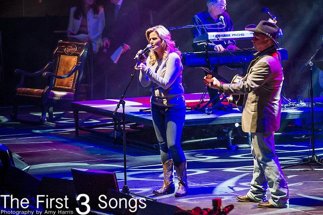 "Trisha Yearwood and Garth Brooks perform at the George Jones Tribute Concert ""Playin' Possum: The Final No Show"" at Bridgestone Arena in Nashville, TN"