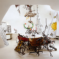 An interesting collection of modern art comprising pieces by Jean Tinguely and Keith Haring furnish the interior of the sculptural house by Niki de Saint Phalle