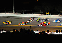 Feb 07, 2009; Daytona Beach, FL, USA; NASCAR Sprint Cup Series driver Kevin Harvick (29) leads the field on the last lap as Denny Hamlin (11) and Jimmie Johnson (48) set off a multi-car accident during the Bud Shootout at Daytona International Speedway. Mandatory Credit: Mark J. Rebilas-