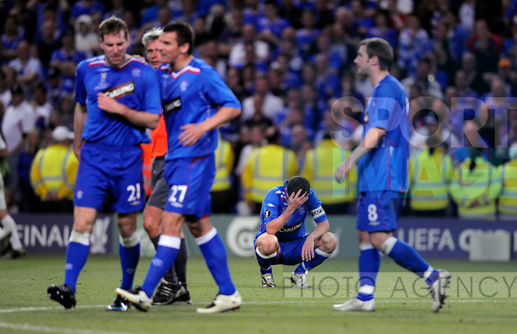 Barry Ferguson of Rangers crouches down in despair following the second Zenit goal during the Europa League Final match at The Etihad Stadium, Manchester. Picture date 14th May 2008. Picture credit should read: Simon Bellis/Sportimage