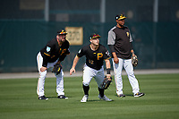 Pittsburgh Pirates outfielder Corey Dickerson (12) breaks to make a play on a fly ball as Garth Brooks (left) and coach Kimera Bartee (18) look on during the teams first Spring Training practice on February 18, 2019 at Pirate City in Bradenton, Florida.  (Mike Janes/Four Seam Images)