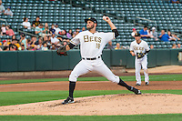 Salt Lake Bees starting pitcher Nate Smith (18) delivers a pitch to the plate against the Tacoma Rainiers in Pacific Coast League action at Smith's Ballpark on September 1, 2015 in Salt Lake City, Utah. The Bees defeated the Rainiers 10-1.  (Stephen Smith/Four Seam Images)