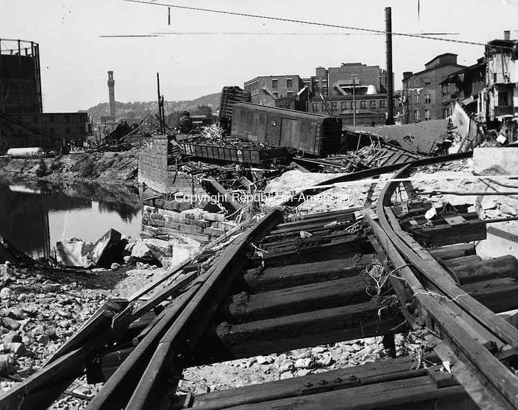 A crazy quilt like pattern emerges from the jumbled rocks and battered freight cars at the washed-out trestle over Bank Street in Waterbury's Brooklyn section.