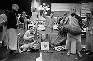 Sunset Boulevard, Hollywood, Los Angeles, CA - March 9, 1969<br /> Hare Krishna&rsquo;s play music on the corner of Hollywood Boulevard and Las Palmas in Los Angeles. They believe chanting Hare Krishna awakens love of God cleanses the hart and make you free of all anxieties.<br /> Sunset Boulevard, Hollywood, Los Angeles, Californie. 9 mars 1969.<br /> Les Krishna chantent et dansent pendant des heures sur les m&ecirc;mes paroles : &ldquo;Hare Krishna&ldquo; qui purifie le c&oelig;ur et &eacute;loigne les anxi&eacute;t&eacute;s et les mauvaises pens&eacute;es.