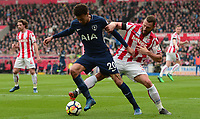 Dele Alli of Tottenham battles for the ball with Erik Peiters of Stoke during the EPL - Premier League match between Chelsea and West Ham United at Stamford Bridge, London, England on 8 April 2018. Photo by PRiME Media Images.