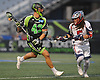 Ryan Walsh #43 of the New York Lizards, left, carries downfield during a Major League Lacrosse game against the Boston Cannons at Shuart Stadium in Hempstead, NY on Thursday, July 20, 2017.