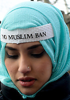 Shannon King wears a band aide that reads No Muslim Ban in protest of President Donald Trump.