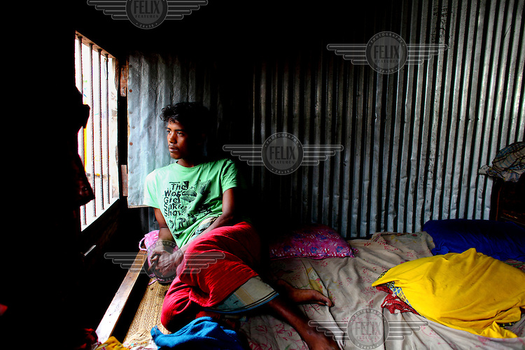 21 year old Juel came to Dhaka when he was 15. He has been working in a textile factory for 6 years. He gets the minimum wage of 3,000 taka (GBP 25) which isn't enough for what he needs. For this reason he sometimes works overtime until midnight. /Felix Features