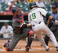 Catcher John Cannon #37 of the Houston Cougars tries to put the tag on Dustin Dickerson #19 of the Baylor Bears in the 2009 Houston College Classic at Minute Maid Park February 27, 2009 in Houston, TX.  Cannon could not hold on to the ball and the Bears defeated the Cougars 3-2. (Photo by Brian Westerholt / Four Seam Images)