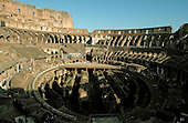 Rome, Italy - April 2, 2006 -- The Colosseum was commissioned by the Roman Emperor Vespasian in AD 72 and was completed in AD 80.  It is considered as Rome's greatest amphitheatre. Deadly gladiatorial combats and wild animal fights were staged there by emperors and wealthy citizens.  It had a capacity of 55,000 people.  Rome, Italy - April 2, 2006 -- The Colosseum was commissioned by the Roman Emperor Vespasian in AD 72 and was completed in AD 80.  It is considered as Rome's greatest amphitheatre. Deadly gladiatorial combats and wild animal fights were staged there by emperors and wealthy citizens.  It had a capacity of 55,000 people.  The platform at center was built recently for events such as rock concerts.  It is built where the original arena floor existed.  The ruins underneath were where the wild animals and gladiators were kept before their combat in the arena..Credit: Ron Sachs / CNP