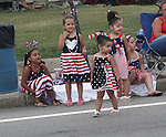 Charlie, Miley, Lila, and Isabella & Olivia Mills watch people before the start he annual Night Before the 4th parade in Randolph on Sunday July 3; 2016.(Photo by Gary Wilcox)