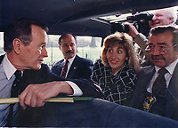 Washington DC., USA, April 12, 1992<br /> President G.W. Bush rides in the press pool van on the way back from attending Palm Sunday church services. The President decided to stop the motorcade outside the White House gates so that he could check on whether the tennis court was still wet, as he wanted to play tennis later that day. This unexpected move on his part caught the members of the press travel pool and the secret service off guard. Credit: Mark Reinstein/MediaPunch