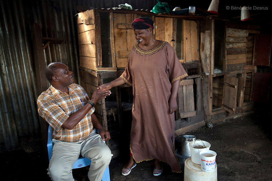 Godfrey(L) and Jane (R), the owners of the Madiaba Busaa Club, at the Madiaba Busaa Club in a Nairobi slum on April 19, 2013. Godfrey and Jane have been brewing Busaa for 22 years. Busaa is a traditional fermented beer made by crudely fermenting maize, millet, sorghum or molasses. At Kshs 35 per liter it is much cheaper than a Kshs120 half-liter bottle of commercial beer. The local brew was legalised in 2010 and since then busaa clubs have become increasingly popular. Drinking is on the rise in Kenya, especially among young people. Photo by Benedicte Desrus