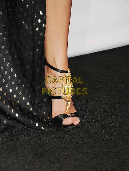 LAS VEGAS, CA- MAY 18: Singer Carrie Underwood, winner of the Milestone Award, (shoe detail) in the press room at the 2014 Billboard Music Awards at the MGM Grand Garden Arena on May 18, 2014 in Las Vegas, Nevada.<br /> CAP/ROT/TM<br /> &copy;Tony Michaels/Roth Stock/Capital Pictures
