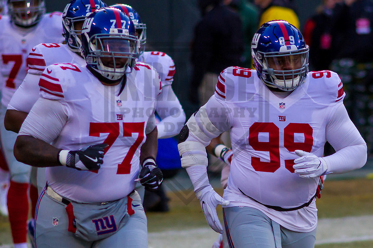 New York Giants guard John Jerry (77) and defensive tackle Robert Thomas (99) prior to a game against the Green Bay Packers on January 8th, 2017 at Lambeau Field in Green Bay, Wisconsin.  Green Bay defeated New York 38-13. (Brad Krause/Krause Sports Photography)