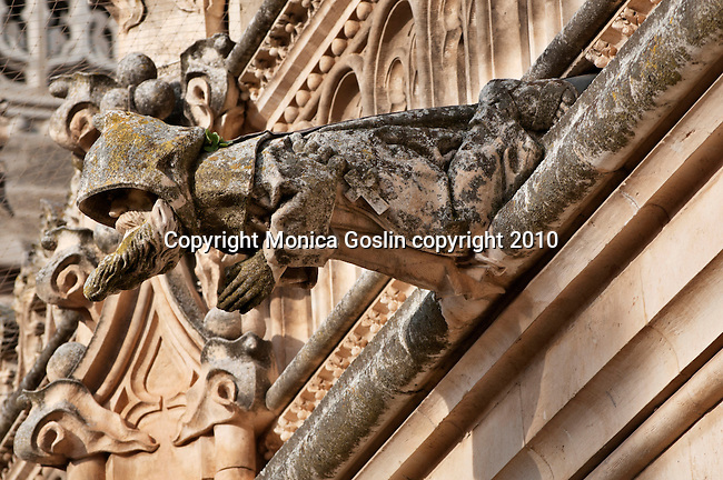 A gargoyle figured as a monk in 15th century the Monastery and Church of San Juan de los Reyes in Toledo, Spain