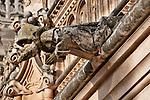 A gargoyle figured as a monk in 15th century the Monastery and Church of San Juan de los Reyes in Toledo, Spain