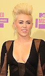 LOS ANGELES, CA - SEPTEMBER 06: Miley Cyrus  arrives at the 2012 MTV Video Music Awards at Staples Center on September 6, 2012 in Los Angeles, California.