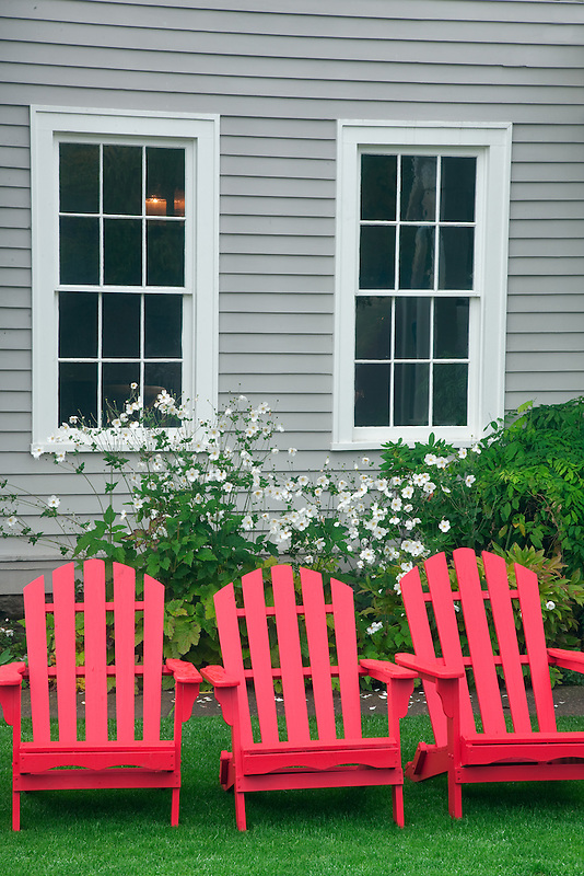 Red chairs with fall color at McCully House Inn. Jacksonville, Oregon