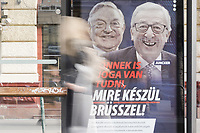 "Billboard bearing portraits of European Commission chief Jean-Claude Juncker (R) and Hungarian-born US investor and philanthropist George Soros and a slogan reading ""You too have a right to know what Brussels is preparing"". Hungary launched a new anti-immigration media campaign on February 19, 2019 in which it accused George Soros and Jean-Claude Juncker of allegedly supporting illegal migration, but which Brussels immediately dismissed as ""fake news""."