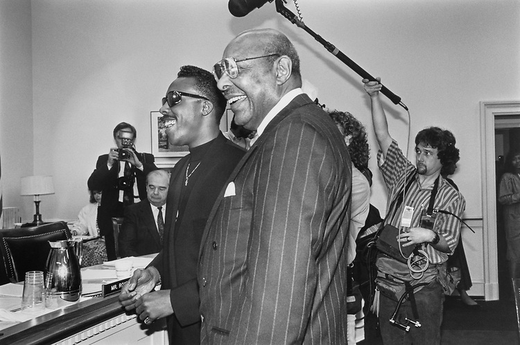 Rep. Louis Stokes, D-Ohio, introduces Arsenio Hall to members of the House Appropriations Subcommittee on Heallth/Education in the Rayburn House Office Building on April 13, 1992. (Photo by Laura Patterson/CQ Roll Call)
