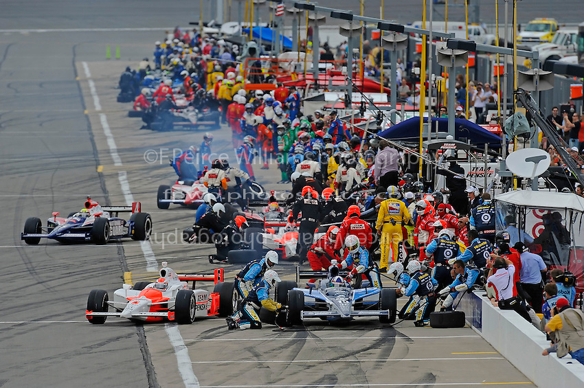 25-26 April, 2009, Kansas City, Kansas, USA.Dario Franchitti (#10) and Ryan Briscoe (#6) make their pit stops at the front of the field under yellow..©F. Peirce Williams 2009 USA.ref: RAW (.NEF) image available