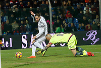 Gonzalo Higuain shoots and scores during the  italian serie a soccer match,between Crotone and Juventus      at  the Scida   stadium in Crotone  Italy , February 08, 2017