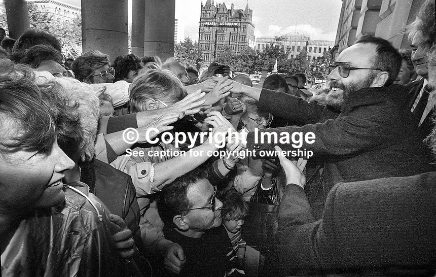 Beirut hostage Brian Keenan gets a warm welcome from wellwishers outside the City Hall, Belfast, N Ireland after his return to his native city early September 1990. He was held for over four and a half years by Arab terrorists. When he was abducted he held a teaching post with the American University of Beirut. His fellow bostage for most of the time was British journalist, John McCarthy. 199009008021<br /> <br /> Copyright Image from Brendan Murphy c/o Victor Patterson, 54 Dorchester Park, Belfast, UK, BT9 6RJ<br /> <br /> Tel: +44 28 9066 1296<br /> Mob: +44 7802 353836<br /> Voicemail +44 20 8816 7153<br /> Skype: victorpattersonbelfast<br /> Email: victor@victorpatterson.com<br /> Email: victorpatterson@me.com (back-up)<br /> <br /> IMPORTANT: If you wish to use this image or any other of my images please go to www.victorpatterson.com and click on the Terms &amp; Conditions. Then contact me by email or phone with the reference number(s) of the image(s) concerned.