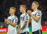 Joshua Kimmich (Deutschland Germany), Toni Kroos (Deutschland Germany), Matthias Ginter (Deutschland Germany) feiern den Sieg mit den Fans - 24.03.2019: Niederlande vs. Deutschland, EM-Qualifikation, Amsterdam Arena, DISCLAIMER: DFB regulations prohibit any use of photographs as image sequences and/or quasi-video.
