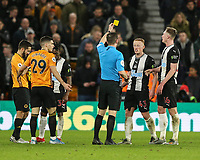 Newcastle United's Matthew Longstaff is booked by Referee Peter Bankes after he fouls Wolverhampton Wanderers' Ruben Vinagre with Newcastle United's Sean Longstaff and Christian Atsu and Wolverhampton Wanderers' Joao Moutinho close by<br /> Photographer Lee Parker/CameraSport<br /> <br /> The Premier League - Wolverhampton Wanderers v Newcastle United - Saturday 11th January 2020 - Molineux - Wolverhampton<br /> <br /> World Copyright © 2020 CameraSport. All rights reserved. 43 Linden Ave. Countesthorpe. Leicester. England. LE8 5PG - Tel: +44 (0) 116 277 4147 - admin@camerasport.com - www.camerasport.com