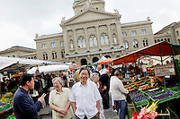 Saturday market in Bundeshausplatz, Bern, Switzerland, 27 August 2011. The Parliament Building is in the background.