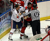 February 22nd 2008:  Peter Aston (12) of the Rochester Amerks and Danny Bois (15) of the Binghamton Senators are restrained by Michael Baker (11) at Blue Cross Arena at the War Memorial in Rochester, NY.  The Senators defeated the Amerks 4-0.   Photo copyright Mike Janes Photography