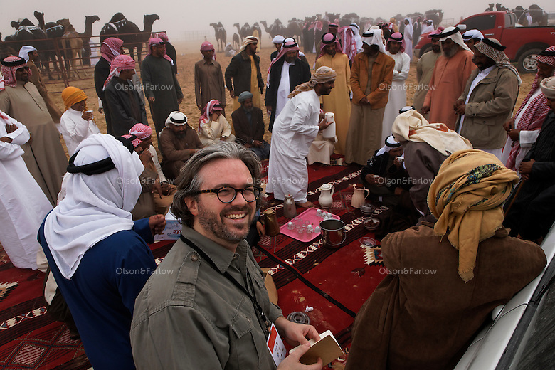 Writer Matthew Teague at the Camel Beauty Contest.  The first Camel Beauty contest was in March of 2007.  This place was just a dusty piece of desert on the edge of the empty quarter before this.  About an hour outside of Abu Dhabi the Al Dhafra Festival put on by the Abu Dhabi Authority for Culture and Heritage is under the patronage of His Highness General Sheikh Mohammed bin Zayed Al Nahyan.