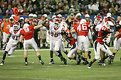 January 5th, 2008:  Rutgers defenders Jamaal Westerman (90), Devin McCourty (21), and George Johnson (31) break through on a punt attempt during the third quarter of the International Bowl at the Rogers Centre in Toronto, Ontario Canada...Rutgers defeated Ball State 52-30.  ..Photo By:  Mike Janes Photography