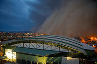 Jul. 5, 2011; Phoenix, AZ, USA; A dust storm converges on Chase Field home of the 2011 All Star Game. Apr. 26, 2011; Phoenix, AZ, USA; A dust storm converges on downtown Phoenix the home to the 2011 MLB All Star Game at Chase Field. haboob sandstorm dust desert monsoon storm chaser chasing city dusk Arizona stadium sports baseball Diamondbacks