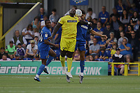 Paul Kalambayi of AFC Wimbledon Adebayo Akinfenwa of Wycombe Wanderers and Will Nightingale of AFC Wimbledon during AFC Wimbledon vs Wycombe Wanderers, Sky Bet EFL League 1 Football at the Cherry Red Records Stadium on 31st August 2019