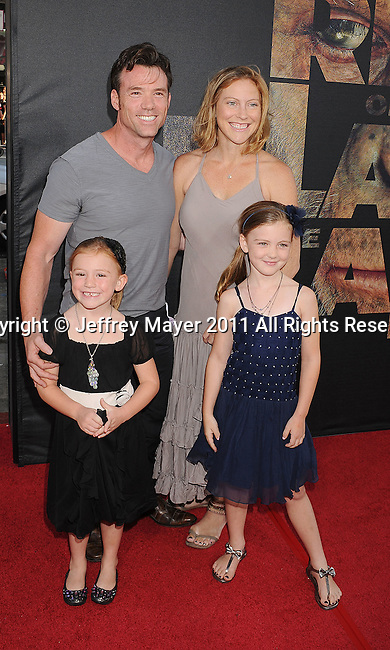 """HOLLYWOOD, CA - JULY 28: Terry Notary and family arrive at the """"Rise Of The Planet Of The Apes"""" Los Angeles Premiere at Grauman's Chinese on July 28, 2011 in Hollywood, California."""