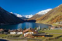 """Italy, Alto Adige - Trentino (South Tyrol), village Vernagt at the end of Valley """"Val Senales"""" (Schnalstal) with Lago di Vernago Reservoir, at background snowcapped summits of Texel Group mountains   Italien, Suedtirol, (Alto Adige - Trentino) das Schnalstal - Seitental des Vinschgau - Dorf Vernagt: am Ende des Schnalstals wird der Schnalser Bach aufgestaut zum Vernagt-Stausee, im Hintergrund die schneebedeckten Gipfel der Texelgruppe"""