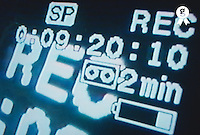 Recording information on television screen, close-up (Licence this image exclusively with Getty: http://www.gettyimages.com/detail/200337529-001 )