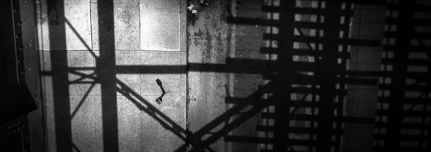 Shadows from the subwat tracks on the street below. Subway series shot in New York between the years 1998 and 2001