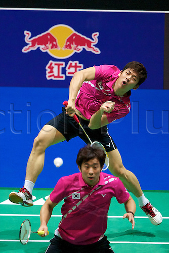 11.03.2012 Birmingham, England. Jing Jae Sung (KOR and Lee Yong Dae (KOR) in action during the Yonex All England Open Badminton Championships at the National Indoor Arena.