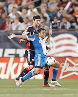 Philadelphia Union midfielder Daniel Cruz (44) attempts to control the ball as New England Revolution defender Stephen McCarthy (26) pressures. In a Major League Soccer (MLS) match, the New England Revolution tied Philadelphia Union, 0-0, at Gillette Stadium on September 1, 2012.