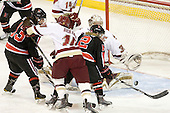 Claire Santostefano (NU - 13), Blake Bolden (BC - 10), Dani Rylan (NU - 2), Molly Schaus (BC - 30) - The Boston College Eagles defeated the visiting Northeastern University Huskies 2-1 on Sunday, January 30, 2011, at Conte Forum in Chestnut Hill, Massachusetts.