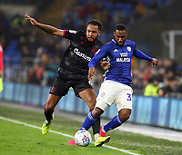 31st January 2020; Cardiff City Stadium, Cardiff, Glamorgan, Wales; English Championship Football, Cardiff City versus Reading; Junior Hoilett of Cardiff City is fouled by Liam Moore of Reading