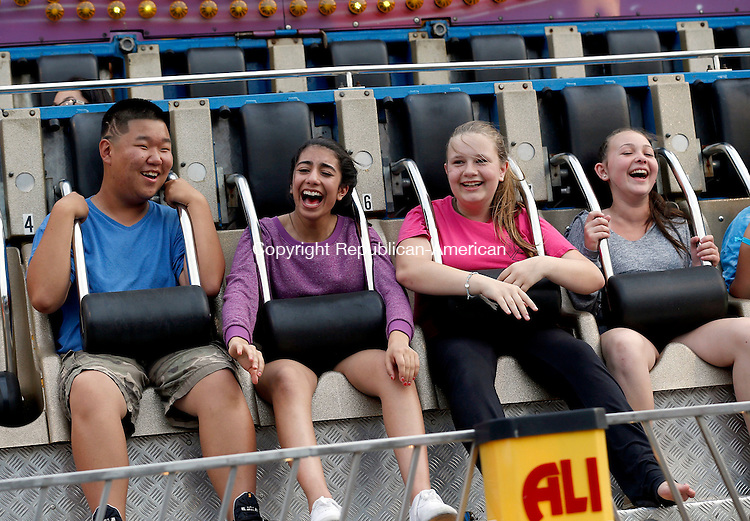 Beacon Falls, CT- 11 June 2015-061115CM05-  From left,  Derek Cha 14,  Fatima Khalid, 13, Hannah Gracy 13, and Alivia McCafrey, 13, all from Beacon Falls ride the Ali Baba during the annual Beacon Hose Carnival in Beacon Falls on Thursday.  The rides, food and entertainment continue Friday from 6 p.m. to 11p.m. then on Saturday from 3 p.m. to midnight with a parade at 6 p.m.  The event is put on by Beacon Hose Co. 1.      Christopher Massa Republican-American