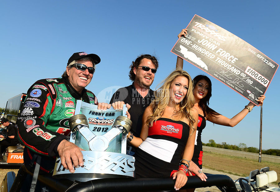 Sept. 22, 2012; Ennis, TX, USA: NHRA funny car driver John Force (left) celebrates after winning the Traxxas Shootout during qualifying for the Fall Nationals at the Texas Motorplex. Mandatory Credit: Mark J. Rebilas-US PRESSWIRE