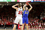 VERMILLION, SD - JANUARY 24: Mike Daum #24 from South Dakota State University spots up for a jumper over Tyler Hagedorn #25 from the University of South Dakota during their game Wednesday night at the Sanford Coyote Sports Center in Vermillion, SD. (Photo by Dave Eggen/Inertia)